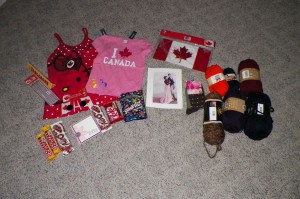 Shirts for the girls, Canadian bits... note the yarn used as filler in the box!