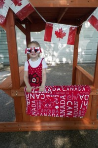Thanks to Karyn for Trinity's Hello Kitty Canadian dress, the funky sunglasses AND the flag banners (I made sure to nab that beach blanket before we moved south!)