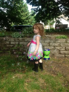 Loving the rubberboots with the party dress