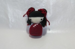 Amigurumi Chinese Kokeshi doll. I love the detail on this one. Her little buns and hanging hair have flowers in front of them. She does not stand on her own, but is just adorable and I used safety eyes so it is infant safe. This one is posted up for sale on my Facebook page. HERE