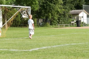 Alex helping out in goal before the game for practice kicks