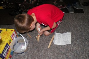 Zander building a catapult