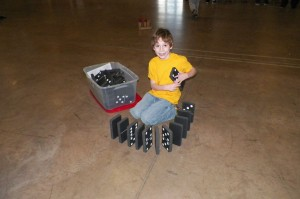 Resident Scout at his day camp with giant dominoes.
