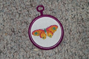 Cross stitch by Gavin for his God Mommy back home!