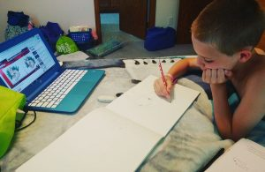 Gavin working on art.