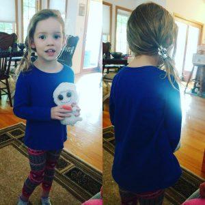 Doing her own hair.