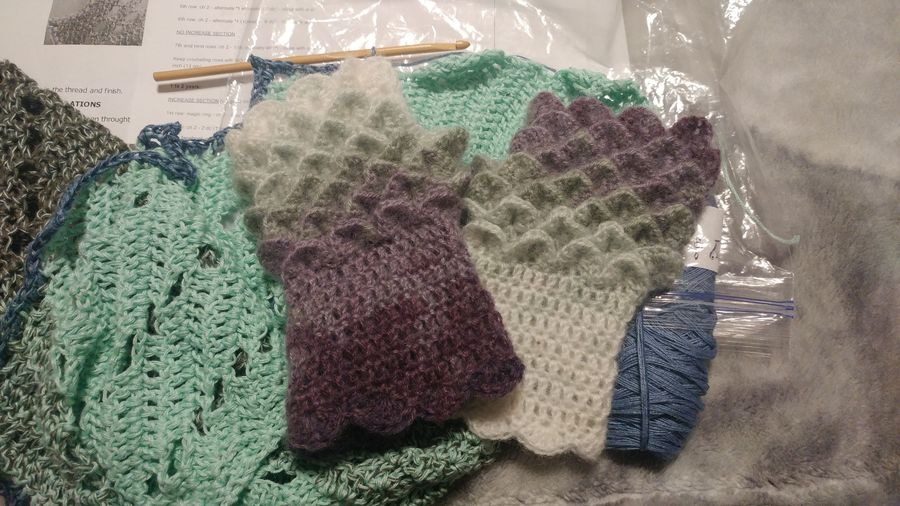 Fingerless dragonscale gloves.