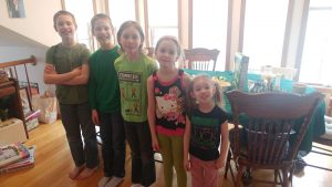 Zander far left... oldest to youngest in their pinch free green.