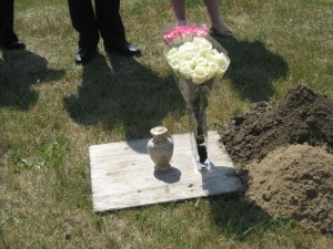 Urn and Roses that Went Into the Grave